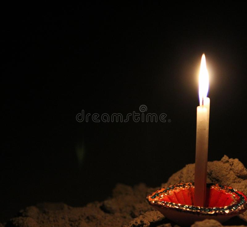 Candles. A candle has the special ability to defy as well as define darkness stock image