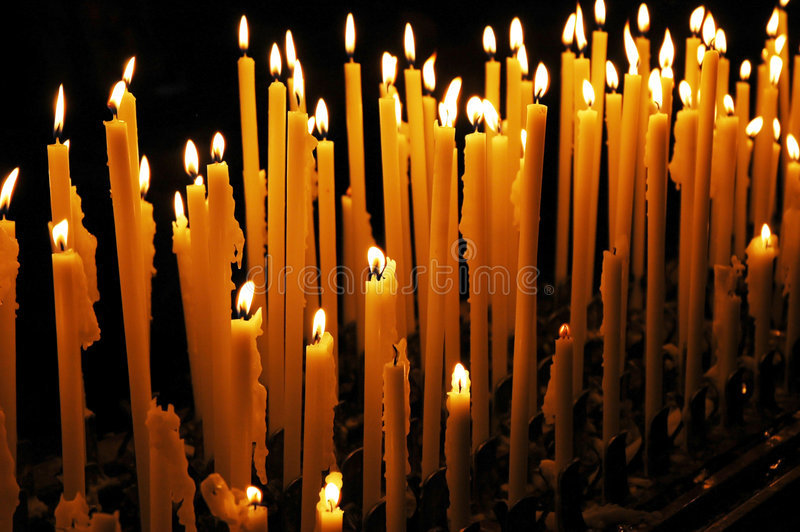 Candles cathedral Milan Italy stock photography