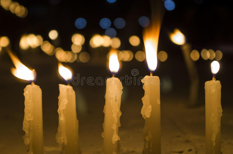 Candles in Ceremonies. Apart for just light, candles are used for a variety of purposes all over the world. From birthdays to death ceremonies, candles are used royalty free stock photos