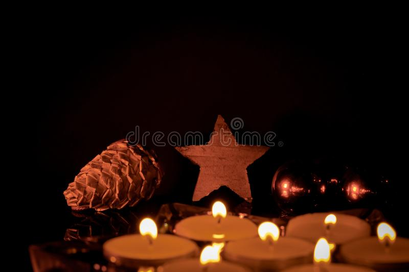 Candles at Christmas with negative space above stock photo