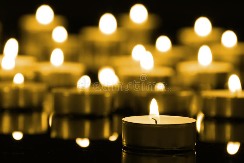 Candles on christmas night signifying hope. Gold. Background. Selective focus stock photo