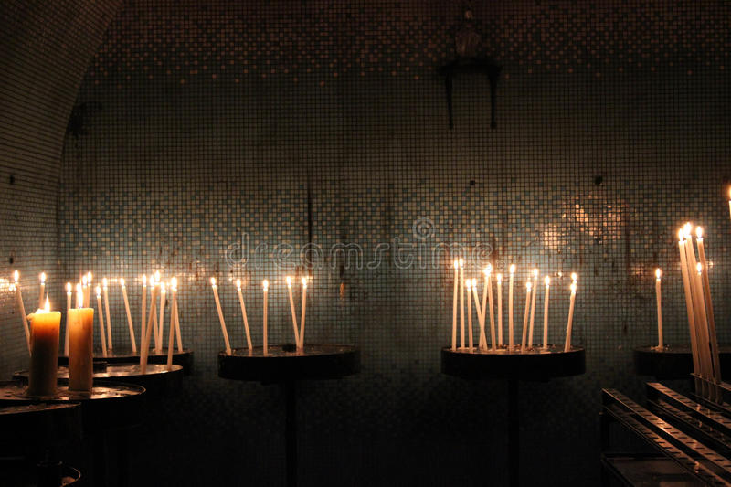 Candles in church on dark background. Candles for offer on a dark background stock images