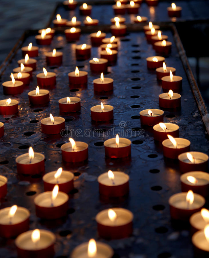 Candles in a church for the prayers. Of the faithful stock photography