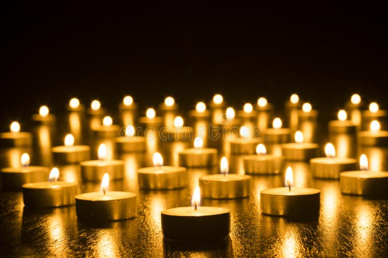 Candles on Dark Background for Thanksgiving, Valentines Day, Happy Birthday, Memorials, Festive, Christmas and Romance royalty free stock photo