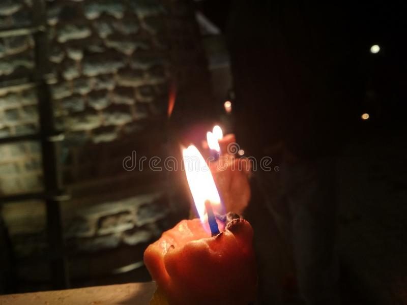 Candles. In dark with their ambient lighting royalty free stock photography