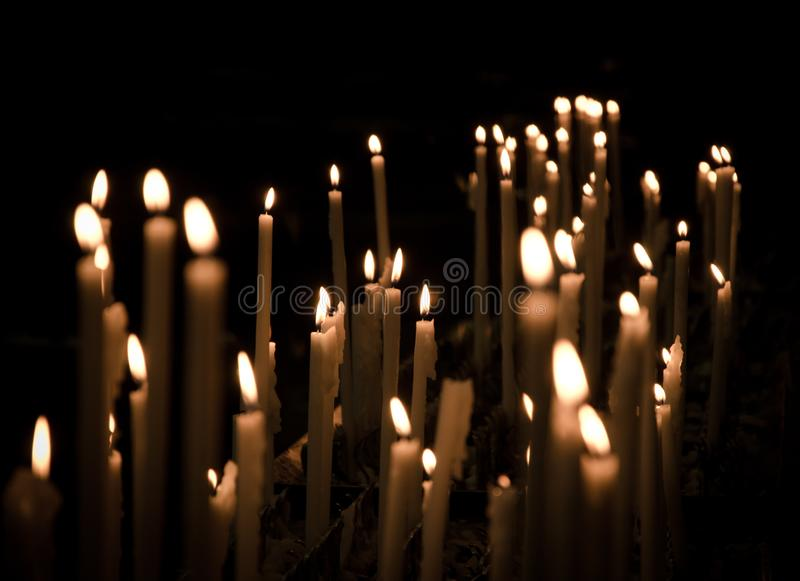 Candles in Duomo di Milano. Candles of Duomo di Milano Light. lifestyle romantic, candle lights pureness, dark, religion, religious royalty free stock image