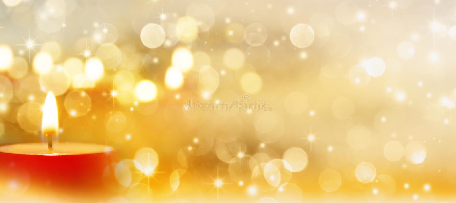 Candles. Festive background in gold with a candle royalty free stock photos