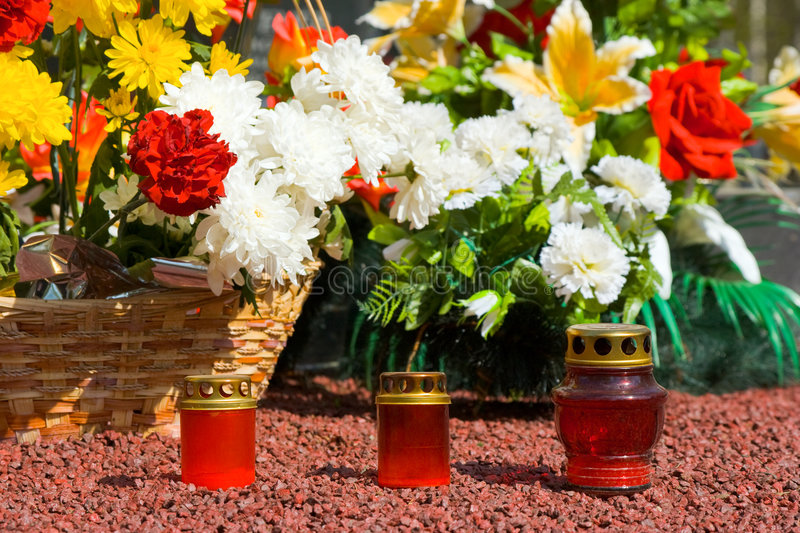 Candles And Flowers At Cemetery Royalty Free Stock Image