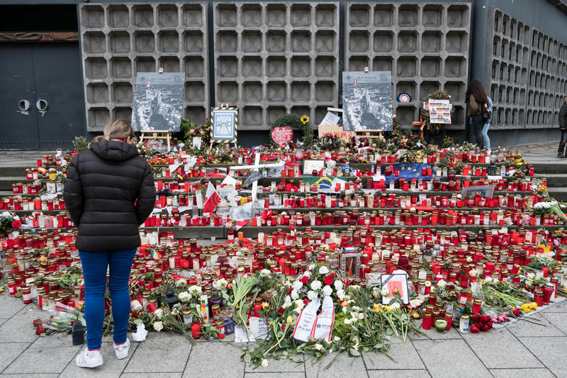 Candles and flowers at christmas market in Berlin royalty free stock photo