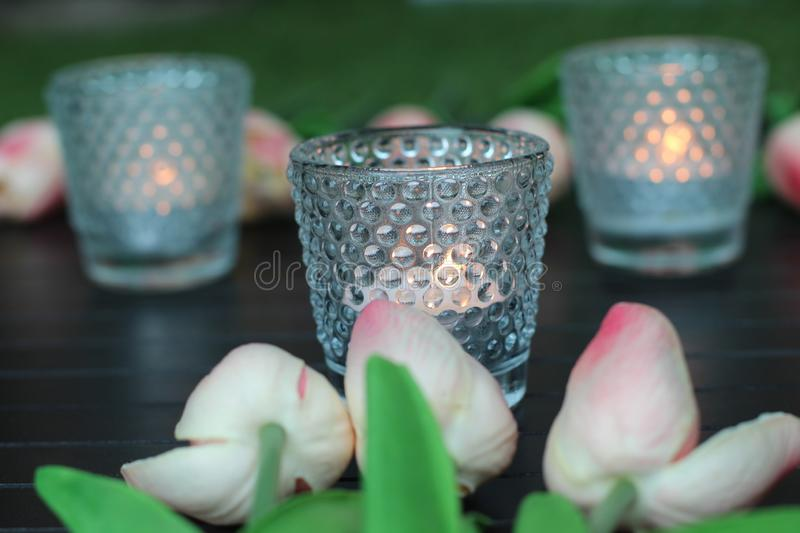 Candles and flowers on the wedding table royalty free stock image