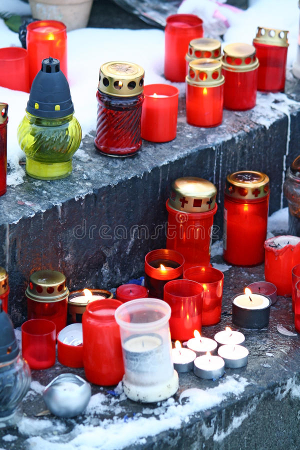 Candles on grave royalty free stock photo