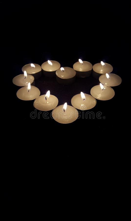 Candles in heart shape royalty free stock photography