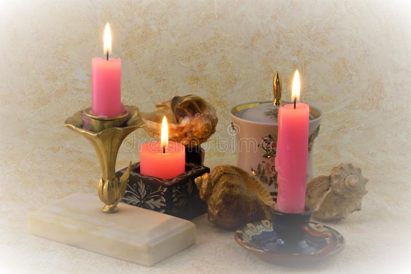 Candles illuminate a beautiful still life royalty free stock image