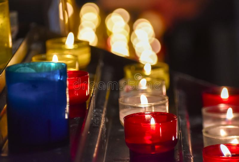 Candles inside a church. Sensation of religiosity and tranquility. Bokeh lights as space for text royalty free stock photos