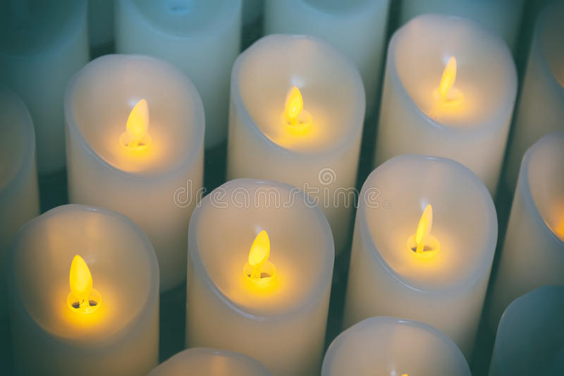 Candles light background of candles group In church.  stock image