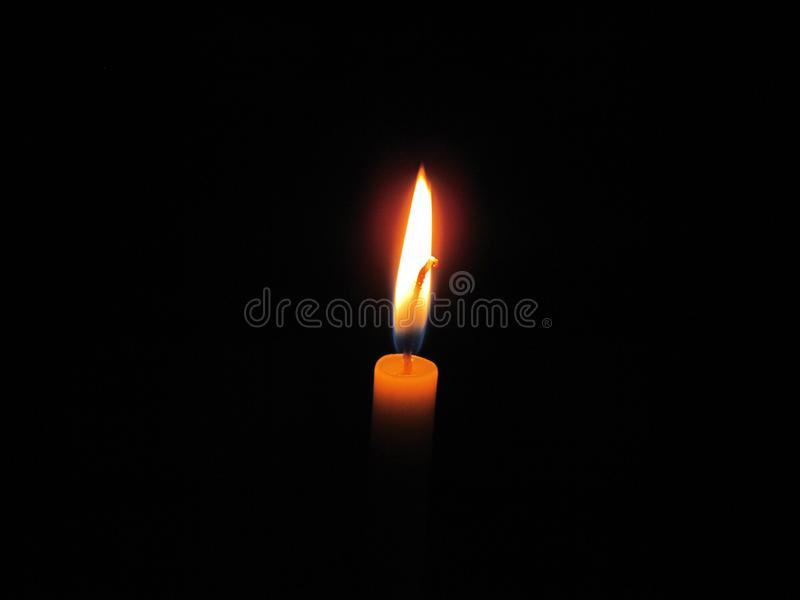 Candles light in the dark. The white rope in the middle of a candle fire conductors. Burning candle royalty free stock photos
