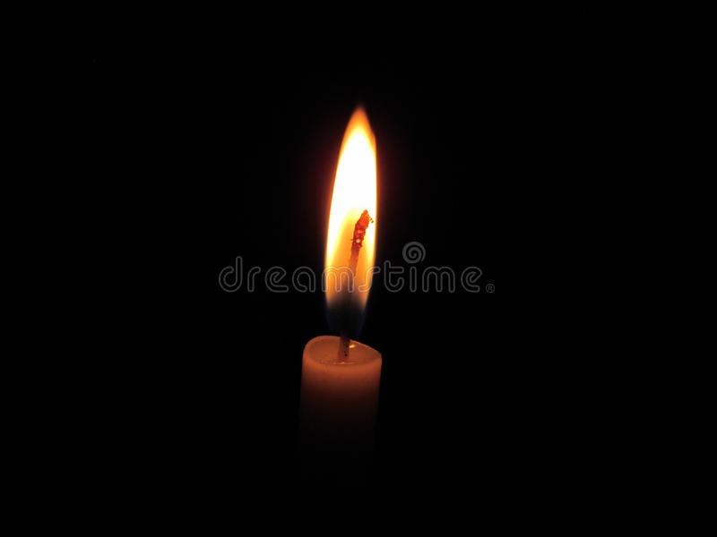 Candles light in the dark. The white rope in the middle of a candle fire conductors. stock images