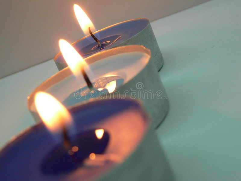 Candles lighted. 3 candles lighted in a row royalty free stock photography