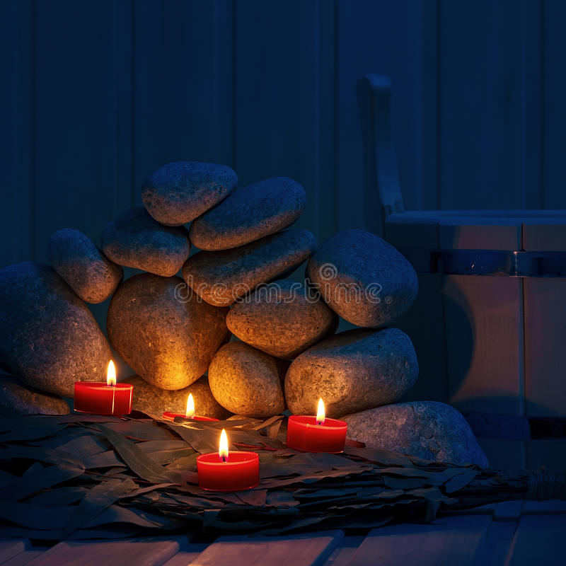 Candles are lit on the background of the stones. Candles are lit on the background of the sauna stones. Preparing for the ceremony bathhouse stock photos