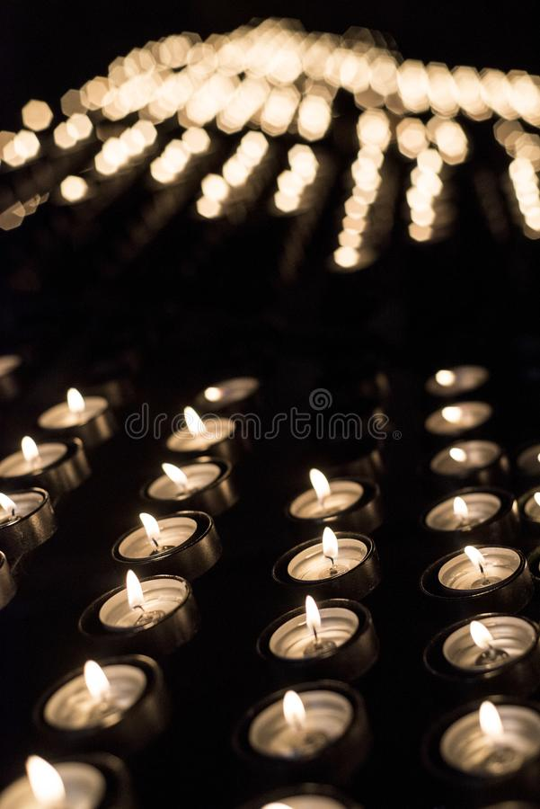 Candles lit in a Christian shrine for spiritual offerings. In southern Spain stock photos