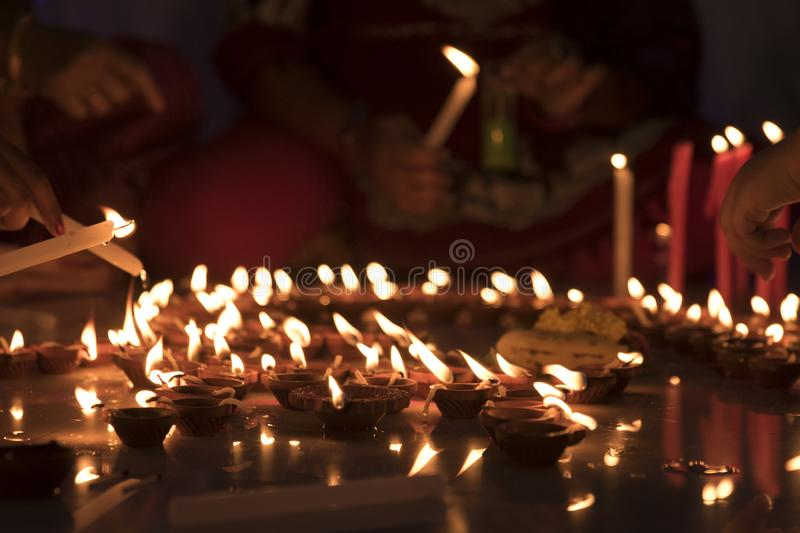 Candles are lit during Diwali festival. Diwali is a festival of light and prosperity in life. Lighting candles is a tradition of India during this festival stock photography