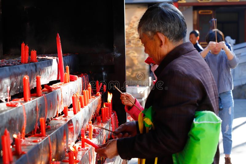 Candles lit by the faithful in the Yantong Temple, a large Buddhist complex in Kunming. Yunnan, China stock photos