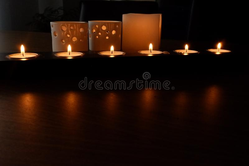 Candles for a warm illumination stock photo