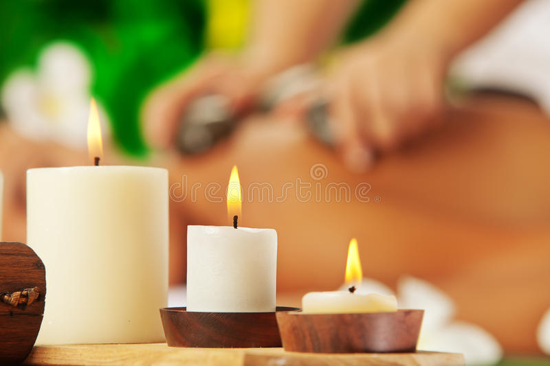 Candles. Portrait of young beautiful woman in spa environment. focused on candles stock photos