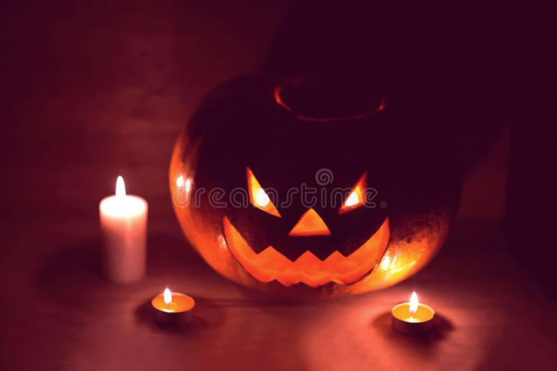 Candles and pumpkin for Halloween in a cramped room royalty free stock photos