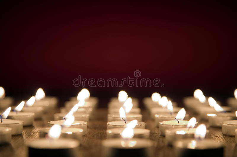 Candles on red background, all saints day concept