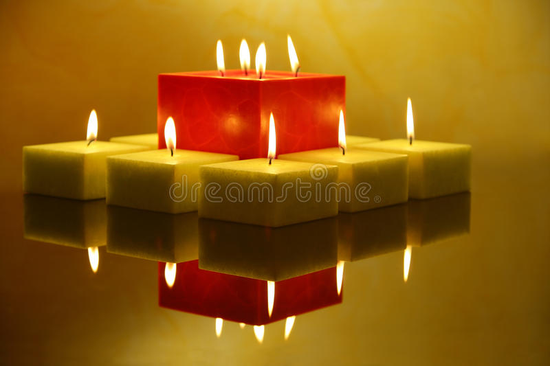 Candles with reflection. Group of green and red candles creating tranquil atmosphere stock photos