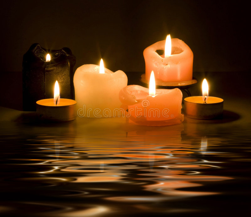Candles and reflection stock photo