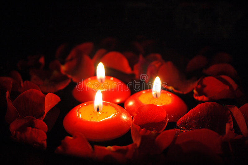 Candles with rose petals stock photo