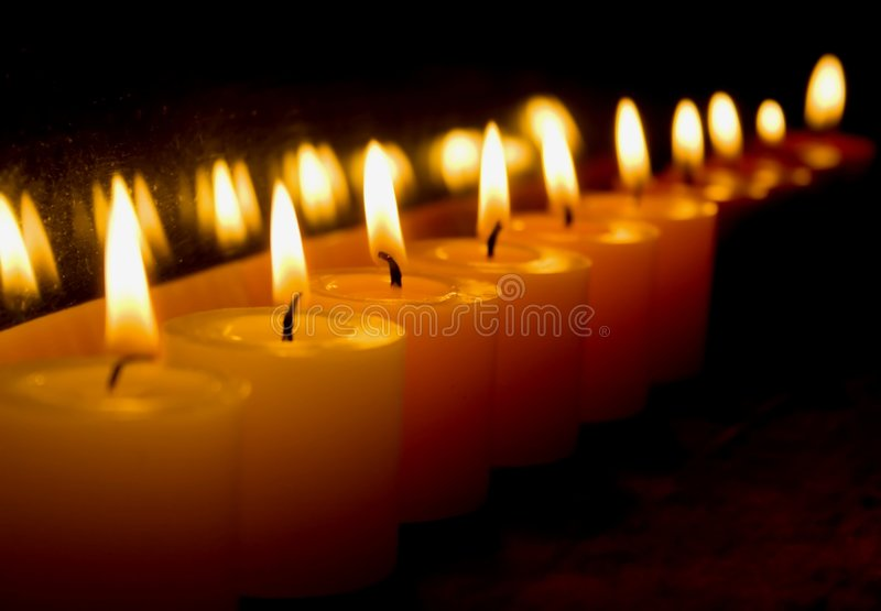 Candles in a row royalty free stock photography