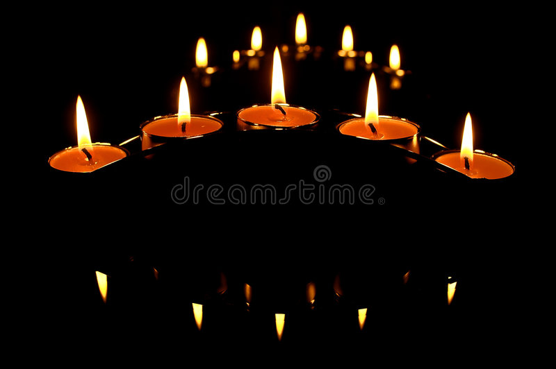 Candles and it's shadows stock images