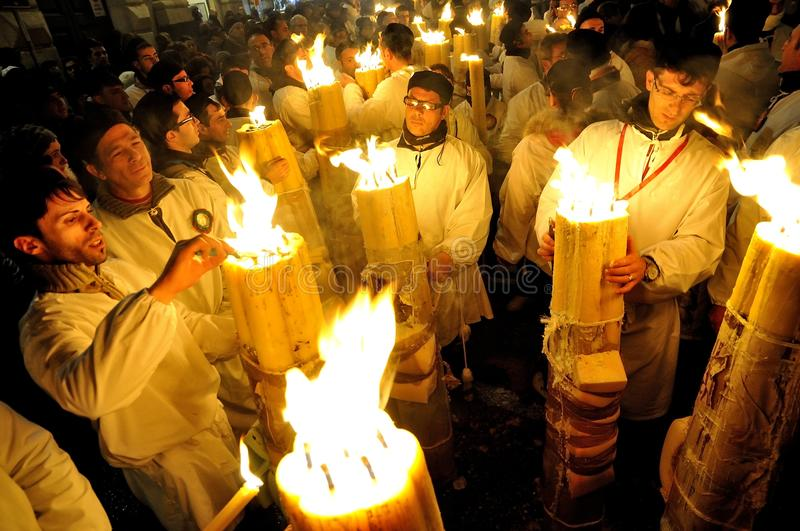 Candles for Saint Agata. Churchgoers are lighting big candles during the crowded festivity of Patron Saint Agata. On 5 of February thousands of white dressed