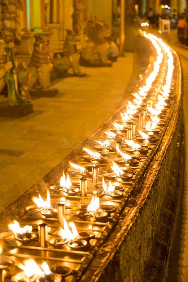 Candles in the Shwedagon pagoda, Yangon, Myanmar stock photos
