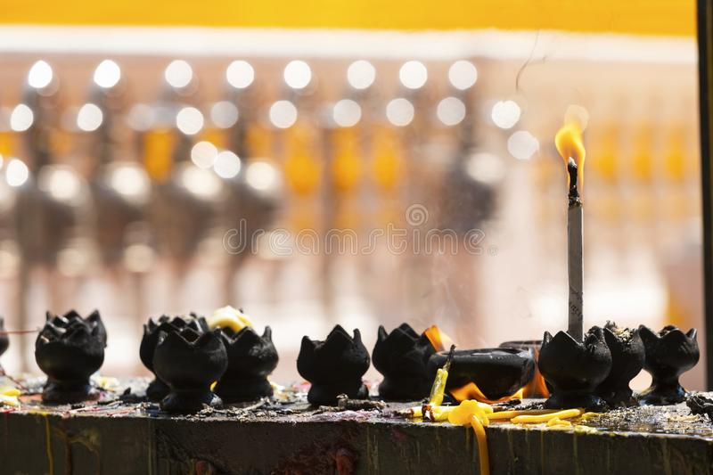 Candles in the temple. Fire in lantern for pray with Buddha statue in temple royalty free stock photography