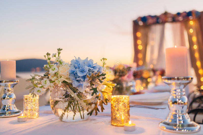 Candles on the wedding table at a banquet stock image