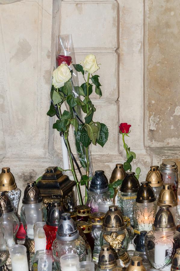 Candles and white and red roses for commemorative Pawel Adamowicz in old town of Gdansk. Gdansk, Poland - January 16, 2019: Candles and white and red roses for stock photos