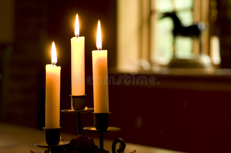 Candles and window stock photo