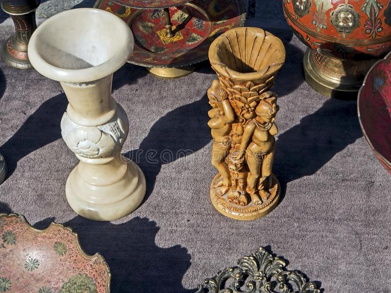 Candlestick in the form of a statuette of a woman at a flea market. In Tbilisi royalty free stock photo
