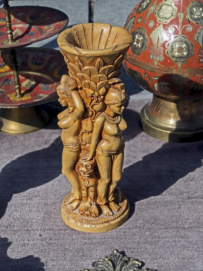 Candlestick in the form of a statuette of a woman at a flea market. In Tbilisi stock photography