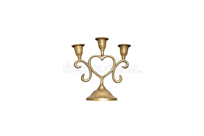 Candlestick made of brass in the shape of a heart with three places for candles, isolated on a white background with a clipping pa royalty free stock photography