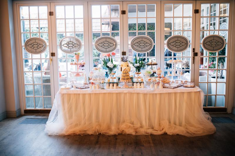 Candy Bar. Delicious sweet buffet with cupcakes. Sweet holiday buffet with cupcakes and other desserts wedding day stock images