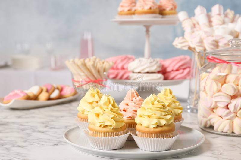 Candy bar with different sweets on white marble table royalty free stock photos
