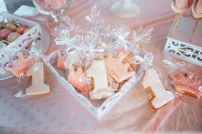 Candy bar for the first birthday for little baby girl. Homemade gingerbread number one stock photography