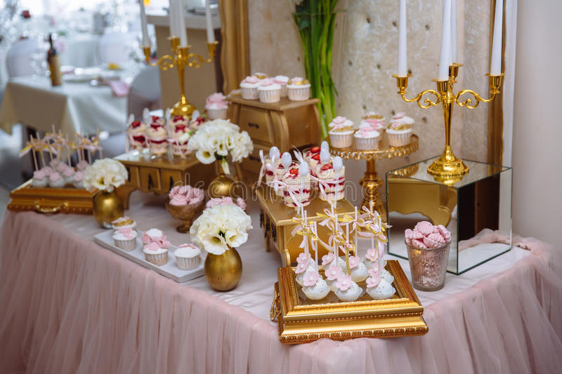 Candy bar. Table with sweets, buffet with cupcakes, candies, dessert. Candy bar. Table with sweets, buffet with cupcakes, candies dessert stock images