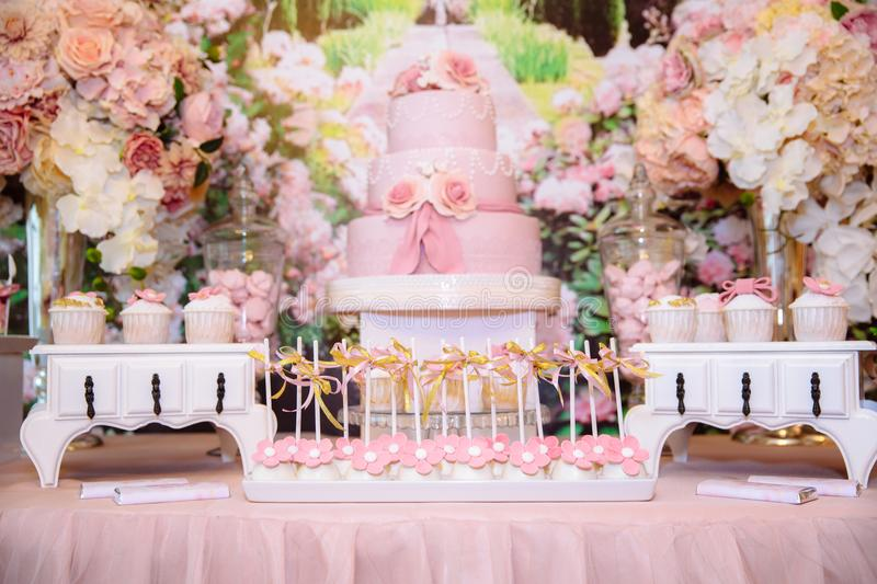 Candy bar and wedding cake. Table with sweets, buffet with cupcakes, candies, dessert. Candy bar. Table with sweets, buffet with cupcakes, candies dessert royalty free stock image