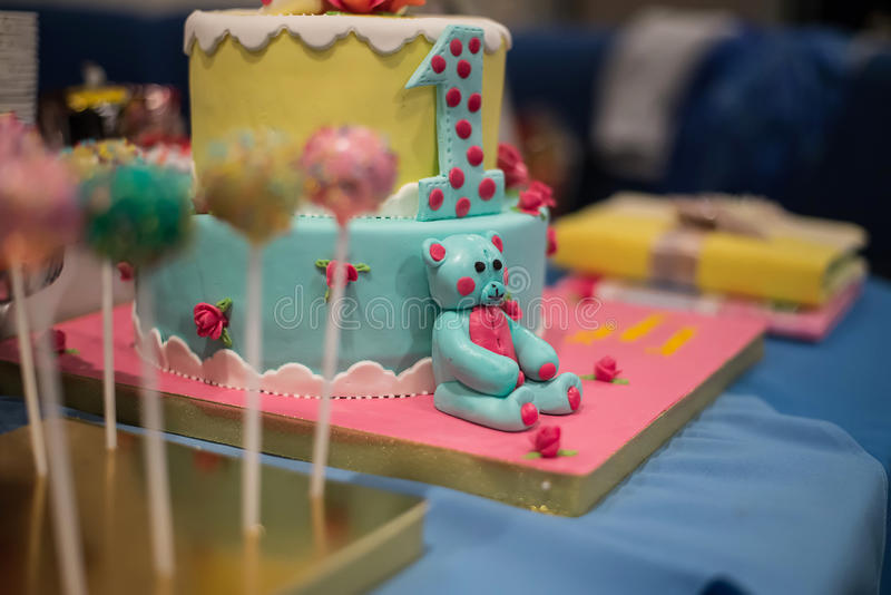 Candy bar and wonderful cake. Bear with candy stock image